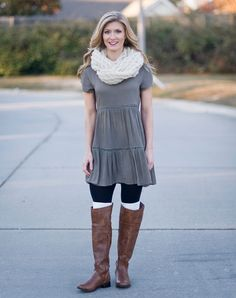 Perfect for a casual Sunday stroll! Olive green dress featuring a scoop neck, button back closure, and tiers trimmed in eyelet lace. Finish the look with our brown riding boots and boot cuffs.