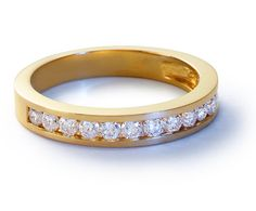 something like this for a band: Channel Set Diamond Ring in 18k Yellow Gold #BlueNile