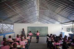 Schools in Haiti often don't have many school supplies. Many Haitian students wear uniforms.