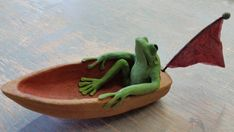 Check out this item in my Etsy shop https://www.etsy.com/listing/386490106/ceramic-frog-in-boat-with-sari-pennant