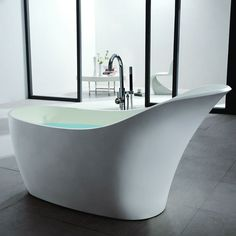 """66"""" Susanna Freestanding Resin Slipper Tub with Overflow. I imagine this tub sitting on a bed of river rock to catch overflow water. So amazing"""