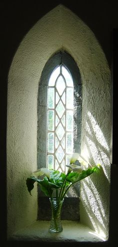 Light streaming through a lancet window in the porch of Saint Thomas's Church