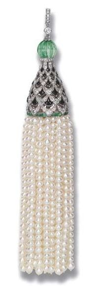 AN EXQUISITE ART DECO DIAMOND, ONYX, EMERALD AND NATURAL PEARL PENDANT. The pearl tassel suspended from an openwork diamond, onyx and emerald cap to the emerald bead top and diamond hoop, circa 1920, with French assay mark for platinum, numbered. #ArtDeco #pendant