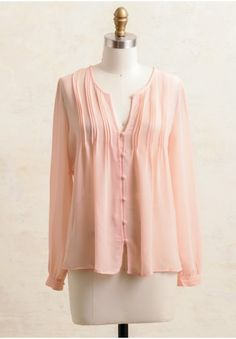 This sweet blouse is created in a lightweight, semi-sheer fabric in a muted pink hue. Featuring a button front with a V-neckline and pleating along the bust, this top is perfect for creating romantic looks on the weekend.
