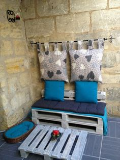 Pallet corner 600x800 Creative pallet corner idea-I like the hanging pillow part of this, behind any chair or bench!