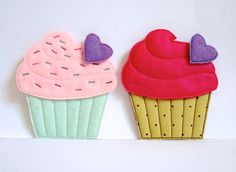 In The Hoop Felt Cupcake Set by KatieLDesigns. *This is a Machine Embroidery pattern. You must have an embroidery machine to use this item.* This set includes designs for a cupcake, icing, icing with sprinkles, heart felties for topping the cupcake, color charts, and written