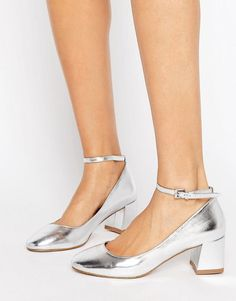 Get this Miss Kg's heeled shoe now! Click for more details. Worldwide shipping. Miss KG Caleb Metallic Mid Heel Shoe - Silver: Shoes by Miss KG, Faux-leather upper, Pin-buckle fastening, Metallic finish, Round toe, Block mid heel, Wipe clean, 100% Polyurethane Upper, Heel height: 5.5cm/2. Part of the Kurt Geiger family of luxury footwear, Miss KG shoes look to unique touches and individual twists. With inspiration taken from the front rows at fashion week and flea market rummages, Miss KG…