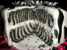 ZEBRA cake instructions: just color half of white cake batter. Drop 2-3 tbsp of first color into center of cake pan, then do the same with the other color, making concentric circles. Keep layering the colors on top of each other. The batter will spread out on its own. COOL!