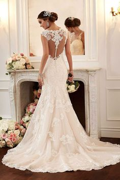 Stella York 6146 - The latest trend in wedding dresses is to make just as much impact with the back of your gown as the front, after all it's what your guests will see as you say your wedding vows.