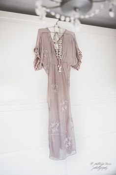 feminine. Would be lovely in cream or pale yellow