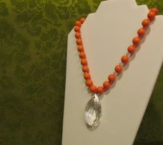 Beautiful coral upcycled vintage beads and an upcycled chandelier crystal necklace. SOLD