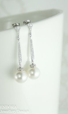 Hey, I found this really awesome Etsy listing at https://www.etsy.com/listing/203009399/long-pearl-earringsbridal-pearl-drop