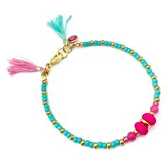 Tassel Bracelet / Friendship Bracelet / Beaded Bracelet / Pink Blue Bracelet / Dainty Bracelet / Stackable Bracelet / Bridesmaid Gift Stackable and delicate bracelet. Perfect for a special day or gift such as bridesmaid gift or for an everyday look. Wear it alone or stack it with more Delika Jewel bracelets. The listing is for ONE Blue and Neon Pink Bracelet with Swarovski Charm and blue/pinkTassels. DIMENSIONS: - 7.5 (19.05cm) -- not your size? please let...