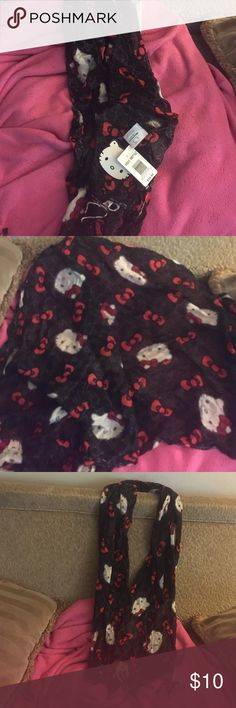 Sheer scarf hello kitty Black sheer scarf with hello kitty's face all over and red bows too! Long and never used Hot Topic Accessories Scarves & Wraps