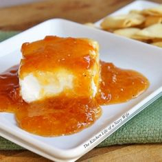 Southern Jezebel Dip  Ingredients   2 cups apricot -pineapple preserves  1/4 cup horseradish sauce  1 teaspoon dry mustard  pepper to taste  1 package cream cheese (8 oz)   Directions   1. Mix first 4 ingredients together and pour over block of cream cheese.   2. Serve with crackers or pita chips.