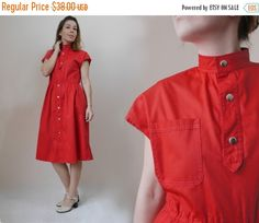 25%OFF     Red Vintage Dress Terrific 80s style vintage dress. Nice mandarin collar, natural elastic waist, metal cuffs buttons, buttons up the front, short sleeves, middle length. Made of polished  cotton fabric. Has a side pockets and single chest pocket.  Material: cotton Color: red  Size: Medium  Measurement Bust and waist already doubled.  Bust: 41 1/2 106 cm  Waist: 36 92 cm  Hips: 44 1/2 86 cm Length: 40 1/2 103 cm  Length of top: 15 38 cm  Please read item description ...
