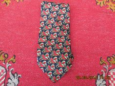 Vintage French Silk Tie, £9.99 by Vintage Corner:   French vintage silk tie by Lancel of Paris, from the 1960s it looks unused with a navy background with motifs of stylised birds in green,red and gold. would make a lovely vintage gift.