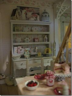Diane Melcher's shabby cottage hutch with Cynthia's cakes