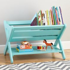 Buy a folding dishrack & turn it into a book caddy. What a smart idea!