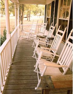 I love the front porch...I could hang out on ours all day, reading a book and sipping coffee.