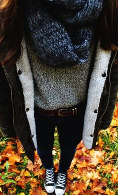 blue scarf, gray sweater, brown belt, army green jacket, black converse