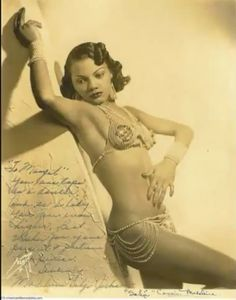 african american vintage burlesque performer.  I can't make out her name,  does anyone know?