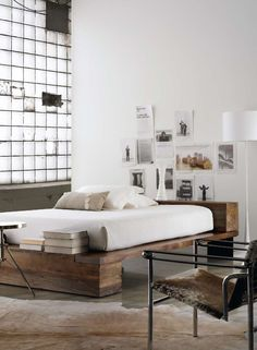 so cool bed..love the atmosphere going on there,,magazine photos,wood,books,simple