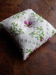 Handmade ornament to be used as a pincushion or as by escie