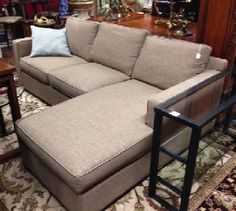 """designed to sit big in small spaces. Very comfortable fiber - down cushions in kid- and pet-friendly light coffee fabric. Storage under chaise. Made in USA. 106"""" wide, 36"""" high 36"""" deep arm, 61"""" chaise. SOLD"""