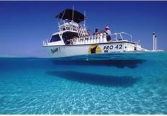 You might be in Turks and Caicos if you can see your boat's shadow on the seafloor. Talk about some clear waters!
