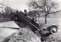 A Kettenkrad demonstrating it's mobility for the camera. Note the interesting small trailer being pulled.
