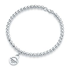 Tiffany & Co. | Item | Return to Tiffany™ mini round tag in sterling silver on a bead bracelet. | United States