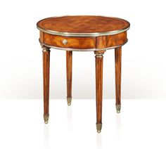 A Neo-classical cerejeira lamp table, the circular brass bound top above a frieze drawer, on turned and fluted legs with leaf cast brass cappings. The original Louis XVI. Teak Table, Table Lamp, Theodore Alexander, Luxury Furniture Brands, French Decor, Kitchen Decor, Louis Xvi, The Originals, Antiques