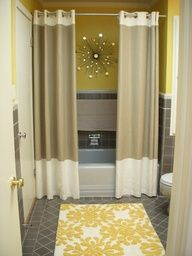 Two shower curtains. Changes the whole feel of a bathroom. Cant believe I have never thought of doing this.