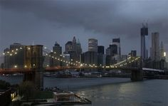 103012sandy-manhattan.jpg  The lights on the Brooklyn Bridge stand in contrast to the lower Manhattan skyline which has lost its electrical supply, Tuesday, Oct. 30, 2012, after megastorm Sandy swept through New York. A record storm surge that was higher than predicted along with high winds damaged the electrical system and plunged millions of people into darkness. (AP Photo/Mark Lennihan)