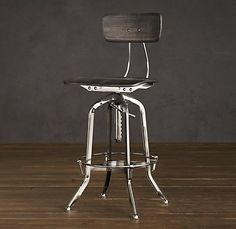 Vintage Toledo Chair Polished Chrome    $445              Our perfect reproduction of the classic vintage-inspired draftsman's chair pairs industrial steel with the warmth of wood seating.  Bent steel base is constructed with a spring-loaded clamp and steel pole for height adjustment  Chair's back adjusts separately  Heavily distressed base…