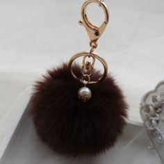 d1c3d634a4 Brown faux fur pom pom Key chain with pearl. New and packaged. Not Zara