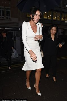 Still in bridal white:The TV presenter swapped her elaborate bridal gown for an elegant white number, which highlighted her slender frame perfectly