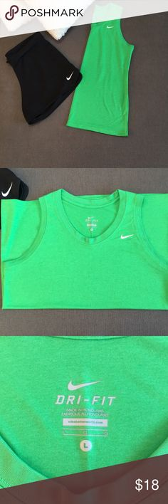 NIKE Dri Fit Tank NWOT   Get signature athletic style in a comfortable design with the Nike® Women's Just Do It Graphic Tomboy Tank Top. Soft Nike® Dry fabric wicks sweat to keep you cool and dry, while the wide racerback design allows for fully unrestricted motion. An allover loose fit offers a relaxed feel for optimum performance. Get closer to your fitness goals and potential with the Just Do It Graphic Tomboy tank.  No stains! Nike Tops Tank Tops