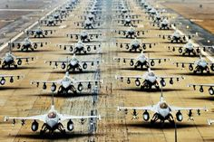 """These F-16s, assigned all over the U.S. and South Korea, as well as one group from the South Korean air force, make a nice image while they taxi down the runway in close formation (an """"elephant walk"""") at Kunsan Air Base. Photo: USAF."""