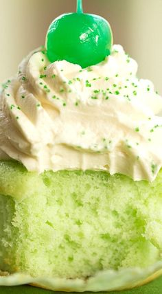 Shamrock Shake Cupcakes Recipe: Green-Tinted Vanilla-Mint Cupcakes with Whipped Cream Cheese Frosting, Perfect for St. Patrick's Day.