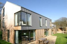 Visit our inspirational timber cladding gallery, with extensive pictures of real domestic and commercial projects using our cedar, Siberian larch and Thermowood exterior cladding. Larch Cladding, House Cladding, External Cladding, Industrial House, Types Of Houses, House Front, House Plans, New Homes, House Design