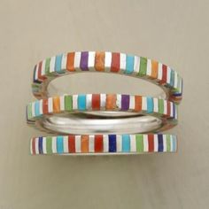 These striped stack rings positively pop with multicolored vibrancy.