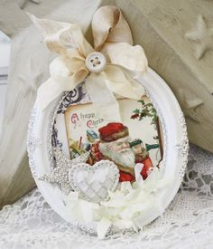 tiny frames painted white, old cards, embellished with pretty ribbon...instant ornament!