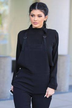 The youngest of the Kardashian sisters, and one of the hottest celebrities on the planet, Kylie Jenner. Kylie is wearing these dope all black dungarees, with cute plaited back hairstyle. Fashion | Street Wear, & Outfits