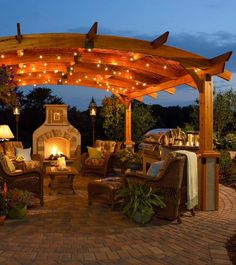 Fire place under Pergola lights. Modern backyards with outdoor fire place, Rattan furniture and Pergola