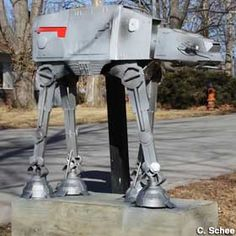 """Kansas City, Missouri - Star Wars """"At-At Walker"""" Mailbox This is a replica of an At-At Walker from Star Wars, which is also a mailbox! Beautifully designed and welded.  [C. Schee, 02/08/2014]  C. Schee adds that, """"Jason made this mailbox after a drunk driver took out the original,"""" and that it's anchored """"with six feet of rebar and 500 pounds of concrete. It's not going anywhere if another driver hits it."""""""