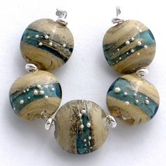 Handmade lampwork lentil beads with fine silver by beadaddicts