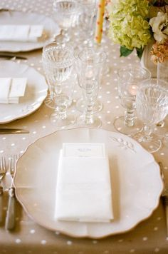 Table setting with polka dot tablecloth.