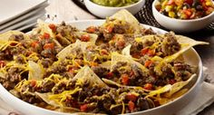 Nachos Grande Supreme: This restaurant-quality appetizer is delicious and quick and easy to prepare. McCormick® Fajitas Seasoning Mix provides a nice citrus background, uniquely different from that of typical taco flavor.